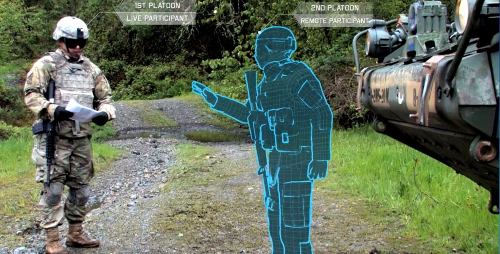 A Stryker Vehicle Commander in a local training area interacts in real time with the avatar of a Soldier participating remotely from a collective trainer (Photo Credit: U.S. Army illustration)