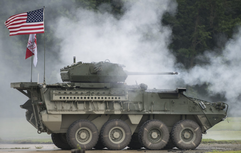 A Stryker Infantry Carrier Vehicle-Dragoon fires 30-mm rounds during a live-fire demonstration at Aberdeen Proving Ground, Maryland, August 16, 2017. Soldiers with 2nd Cavalry Regiment spent six weeks at Aberdeen testing and training on the new Stryker vehicle and a remote Javelin system, which are expected to head to Germany early next year for additional user testing (Photo Credit: Sean Kimmons)