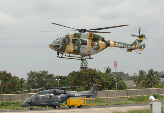An Indian Army ALH lifts off near an Indian Navy model, fitted with a chin-mounted surface-search radar. HAL today was awarded a contract for 41 additional Advanced Light Helicopters (HAL photo)