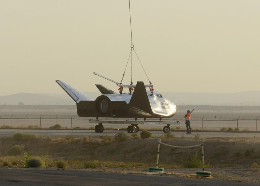 The Dream Chaser prepares for a captive carry test August 30, 2017, at Edwards Air Force Base, California. The test was part of the spacecraft's Phase Two flight test efforts to advance the orbiter closer to space flight (U.S. Air Force photo/Kenji Thuloweit)