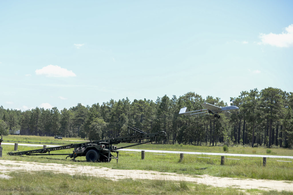 Fort Bragg, North Carolina – A RQ-7BV2 Shadow Unmanned Aerial System belonging the Detachment 1, D Company, 236 Brigade Engineer Battalion propels off its launcher at about 80 mph at an airfield near Fort Bragg, August 18, 2017. The flight is one of many conducted by Detachment 1. Soldiers during their six-week-long New Equipment Training, which was required after the unit received the newest version of the Shadow (Photo Credit: U.S. Army photo by Staff Sgt. Mary Junell)