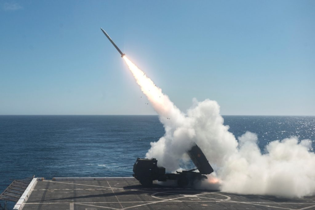 The High Mobility Artillery Rocket System (HIMARS) is fired from the flight deck of the amphibious transport dock ship USS Anchorage (LPD-23) during Dawn Blitz 2017 over the Pacific Ocean, October 22, 2017 (U.S. Navy photo by Mass Communication Specialist 2nd Class Matthew Dickinson/Released)