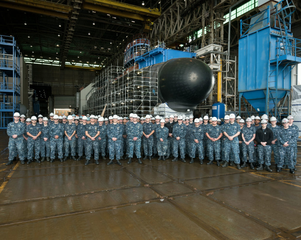 The USS South Dakota crew poses at the site of SSN 790's construction in Groton, Connecticut