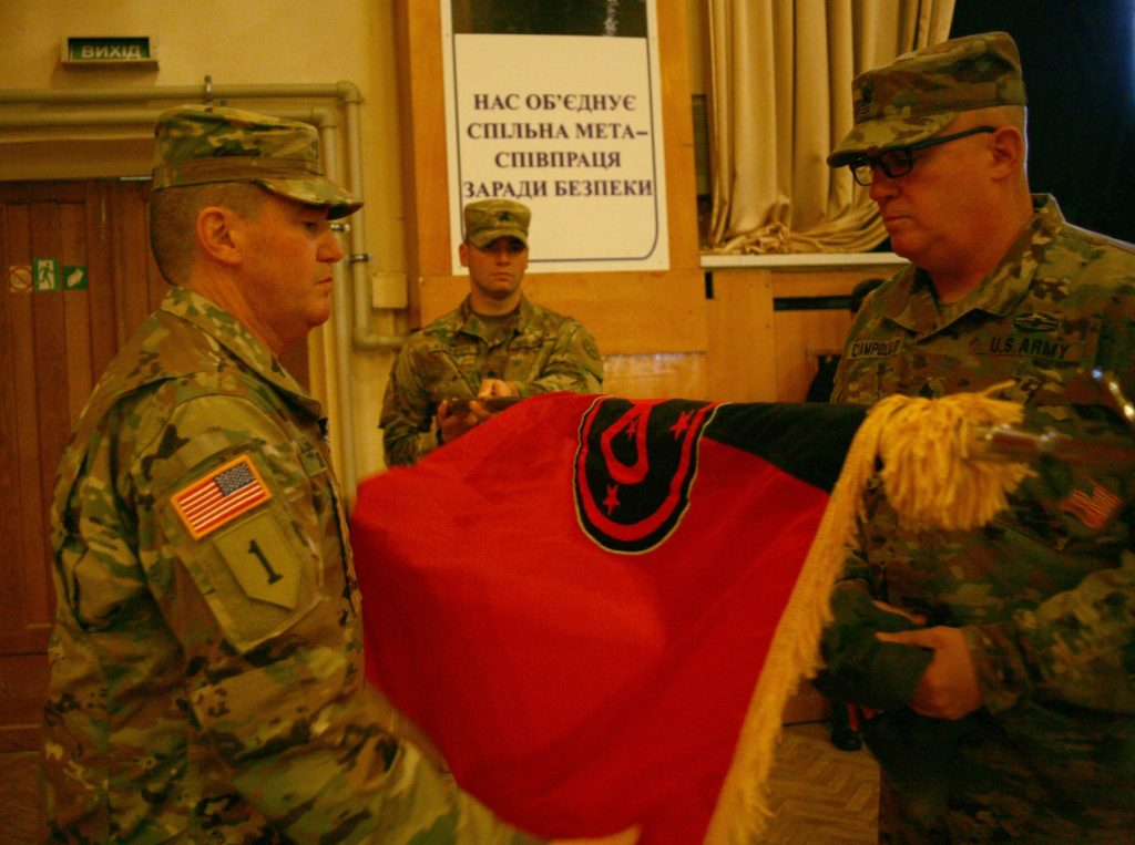 Colonel Dennis Deeley, the Joint Multinational Training Group – Ukraine commander, and Command Sergeant Major Thomas Ciampolillo uncases the 27th Infantry Brigade Combat Team's colors during a JMTG-U Transfer of Authority ceremony here November 22. During the ceremony Soldiers from the New York Army National Guard's 27th Infantry Brigade Combat Team (IBCT) took command of the JMTG-U from the Oklahoma National Guard's 45th IBCT, who have been in Ukraine since January (Photo Credit: Sergeant Alexander Rector)
