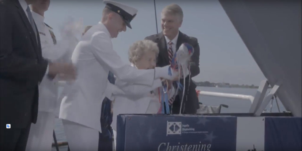 Mrs. Ima Black, MCPON Black's widow and a World War II Navy veteran herself, broke a bottle of sparkling wine across the bow to formally christen the ship, a time-honored Navy tradition