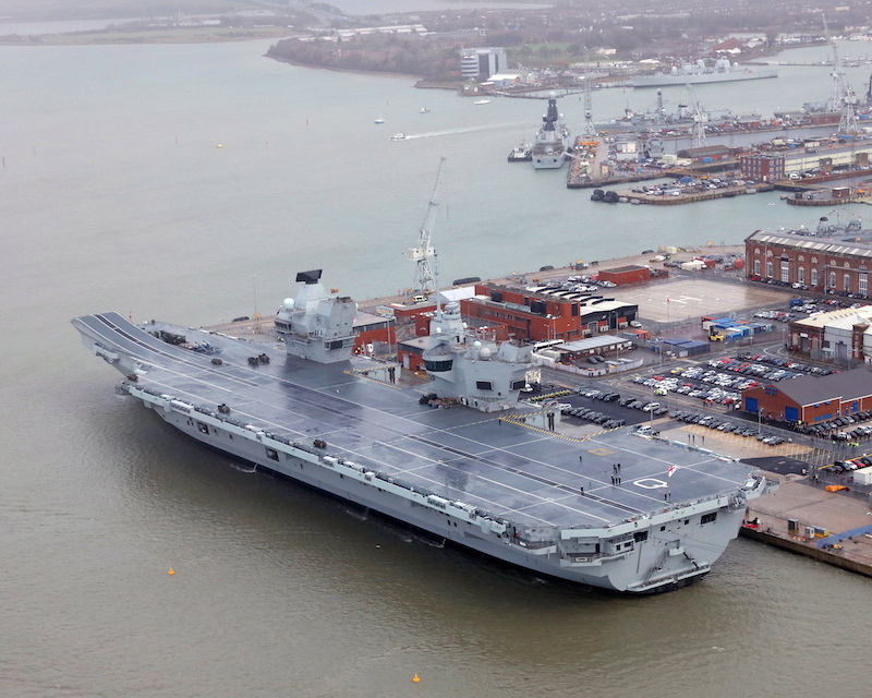 Ten years after it was ordered, the Royal Navy's new aircraft carrier, HMS Queen Elizabeth (R08), was commissioned into the Royal Navy fleet. It is seen here flying the White Ensign (UK MoD photo)