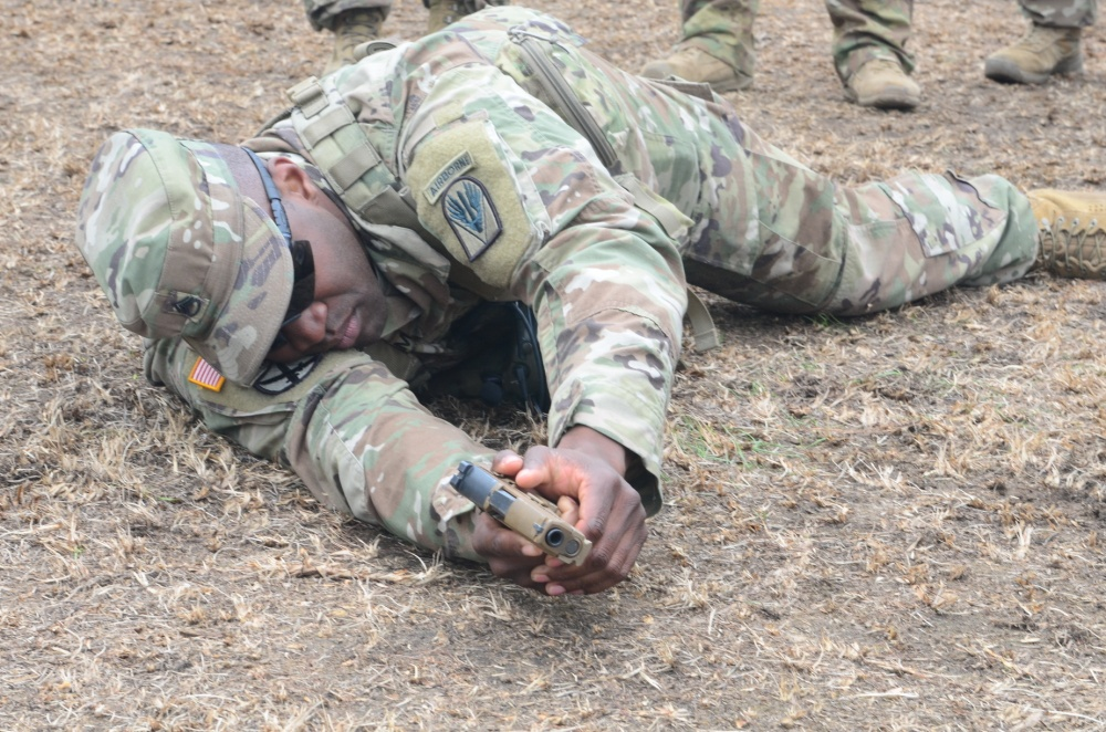 Army Staff Sergeant Curtis Graham demonstrates how to properly shoot the new XM17 pistol from the prone position at the Joint Readiness Training Center at Fort Polk, Louisiana, January 19, 2018. The Army plans to purchase more than 200,000 of the new pistols (Army photo by Sergeant Ryan Tatum)