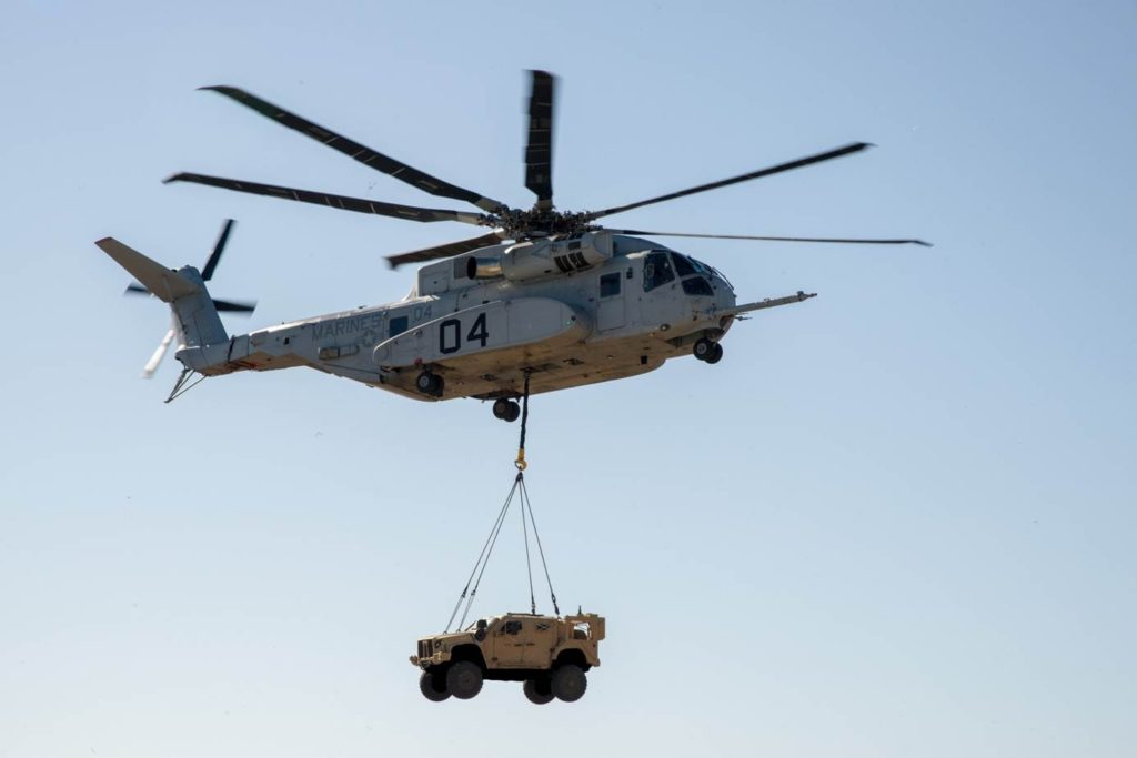 A CH-53K King Stallion lifts a Joint Light Tactical Vehicle during a demonstration, January 18. Using the single point hook, the helicopter hovered up to 100 feet/30.5 meters for approximately 10 minutes while carrying the 18,870-pound/8,559-kg vehicle (U.S. Navy photo)