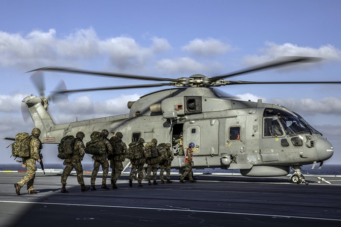 Royal Marines launch 'assault' from HMS Queen Elizabeth (R08)