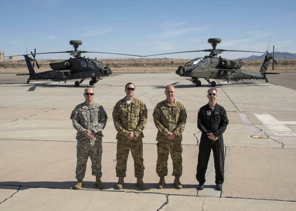 Test unit pilots for the JAGM LUT are (left to right): Chief Warrant Officer 3 Justin Porter, Master Gunner, Gunnery Branch, Directorate of Training and Doctrine (DOTD), Fort Rucker, Alabama; Chief Warrant Officer 5 John Bilton Brigade AH-64D/E Subject Matter Expert, 110th Aviation Brigade, Fort Rucker, Alabama; Chief Warrant Officer 5 Scott Jackson, AH-64D/E Recon and Attack Standardization, Training and Doctrine Command Capability Manager (TCM) Recon Attack, Fort Rucker, Alabama; and Mr. Michael Kennedy, Experimental Test Pilot, Aviation Flight Test Directorate, Redstone Test Center, Alabama (Photo Credit: U.S. Army photo by Tad Browning, U.S. Army Operational Test Command Public Affairs)