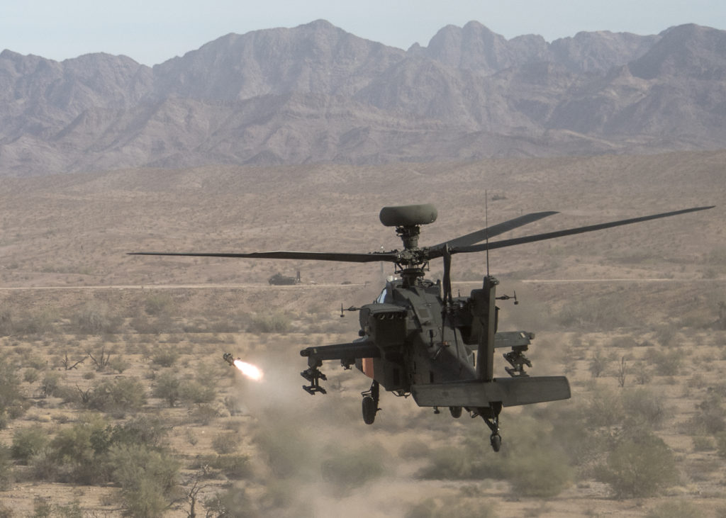 Pilots fire the new Joint Air-to-Ground Missile being tested at Cibola Range, Yuma Proving Ground, Arizona, in support of deliberate attack mission against armor ground vehicle targets (Photo Credit: U.S. Army photo by Tad Browning, U.S. Army Operational Test Command Public Affairs)