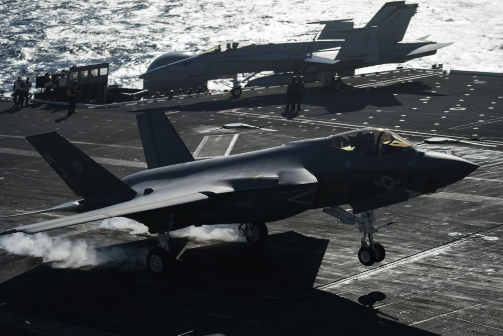 An F-35C Lightning II assigned to the Rough Raiders of Strike Fighter Attack Squadron (VFA) 125 performs a touch and go on the flight deck of the Nimitz-class aircraft carrier USS Abraham Lincoln (CVN-72) (U.S. Navy photo by Chief Mass Communication Specialist Mark Logico/Released)