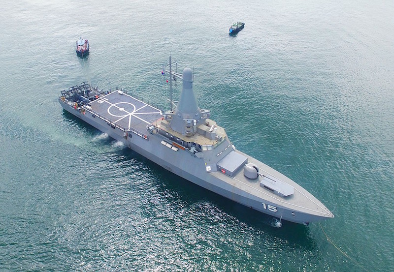 Taken from an unusual angle, this picture of the first Littoral Mission Vessel (LMV), RSS Independence, shows the large rear flight deck, the stern RHIB handling ramps, and the forward section with 76-mm gun turret immediately in front of the vertical missile launcher (Twitter photo)