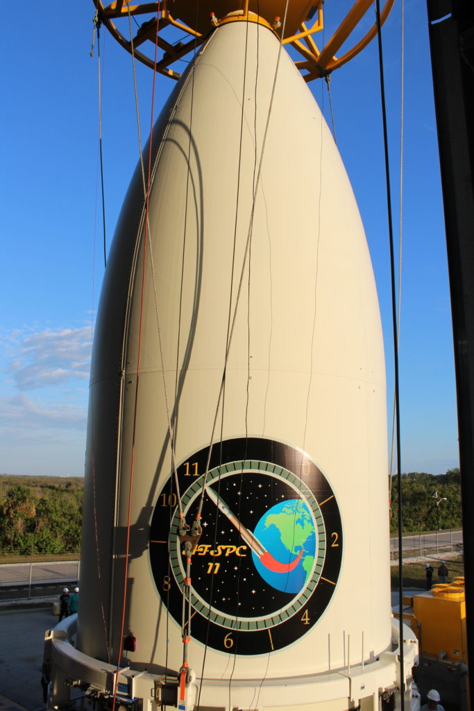 The Air Force's AFSPC-11 mission, encapsulated inside a 5-meter payload fairing, is mated to its United Launch Alliance (ULA) Atlas V booster inside the Vertical Integration Facility (VIF) at Cape Canaveral's Space Launch Complex-41 (Photo credit: United Launch Alliance)