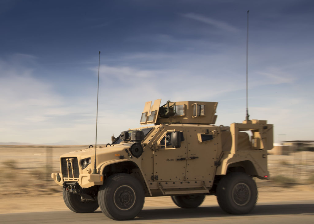 Marines with Weapons Company, 1st Battalion, 7th Marine Regiment, Twentynine Palms, California, run a Joint Light Tactical Vehicle (JLTV) down the road during JLTV operational testing at Twentynine Palms' Marine Corps Air Ground Combat Center (Photo Credit: U.S. Army photo by William C. Beach, U.S. Army Operational Test Command Test and Documentation Team)