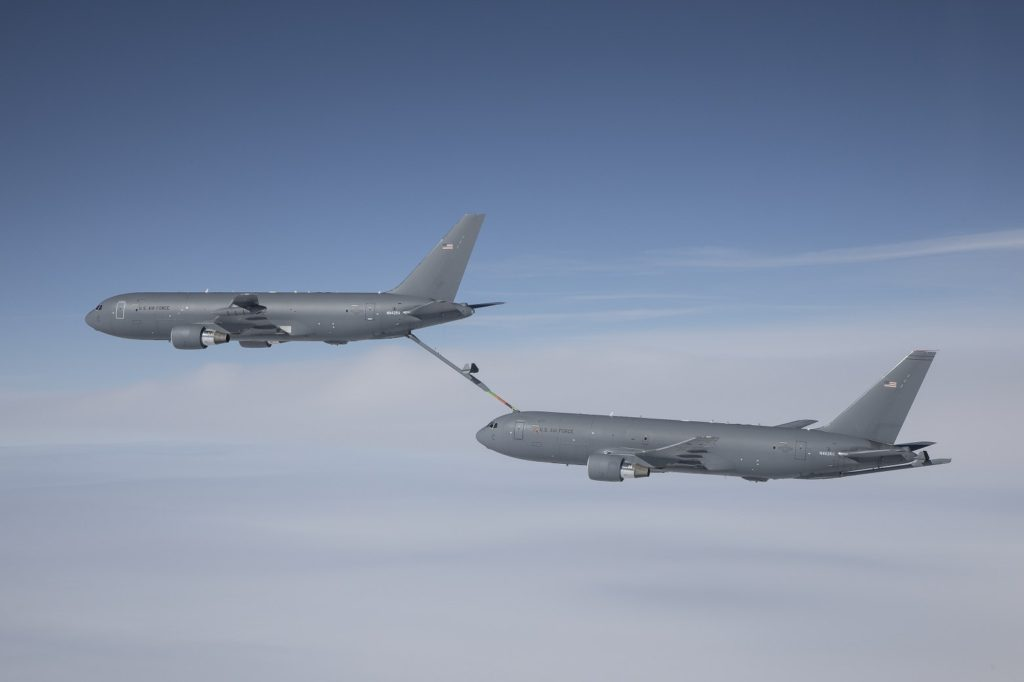 A Boeing KC-46 Pegasus tanker refuels a second KC-46 Pegasus, transferring 146,000 pounds/65,700 liters of fuel as part of its «on-load» certification testing. The KC-46's refueling boom allows it to transfer up to 1,200 gallons/4,542 liters of fuel per minute
