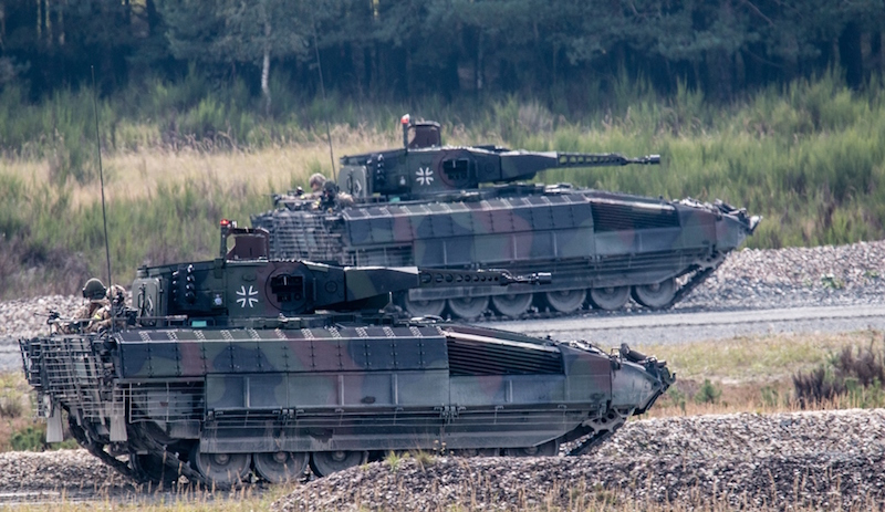Two Puma IFVs during their first public presentation at the Grafenwoehr training ground in Bavaria in September. The 30-mm stabilized gun guarantees a high first-shot hit capability (Bundeswehr photo)