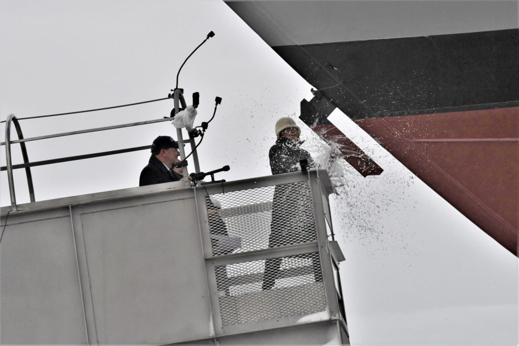 Ship sponsor Jill Donnelly christened LCS-17, the future USS Indianapolis, in Navy tradition by breaking a champagne bottle across the ship's bow