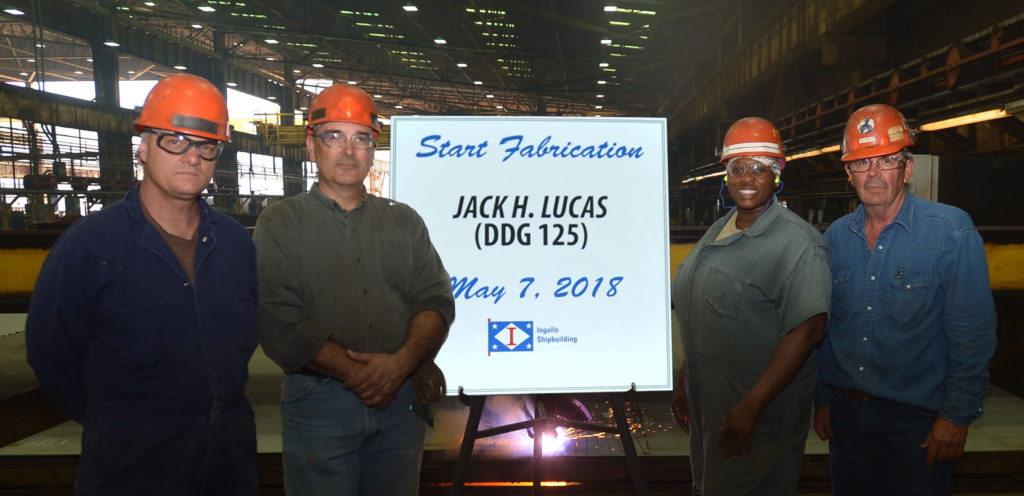 Shipbuilders in Ingalls' Steel Fabrication Shop, from left, Paul Perry, Donald Morrison, Queena Myles and Paul Bosarge, celebrate Start of Fabrication for USS Jack H. Lucas (DDG-125) on May 7, 2018 (Photo by Shane Scara/HII)