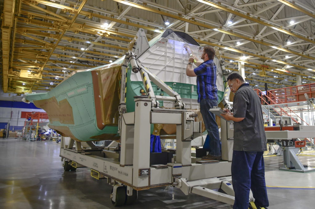 Northrop Grumman quality team performs final inspection of an F-35 center fuselage produced by the company at its Palmdale Aircraft Integration Center of Excellence