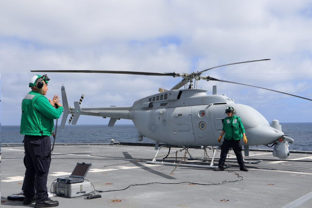 PACIFIC OCEAN (June 21, 2018). Aviation Machinist's Mate 2nd Class Salvatore Green, left, and Aviation Electronics Technician 3rd Class Jake Price, both assigned to Air Test and Evaluation Squadron (VX) 1, prepare the MC-8C Fire Scout unmanned helicopter for launch aboard the littoral combat ship USS Coronado (LCS-4) (U.S. Navy photo by Ensign Jalen Robinson/Released)