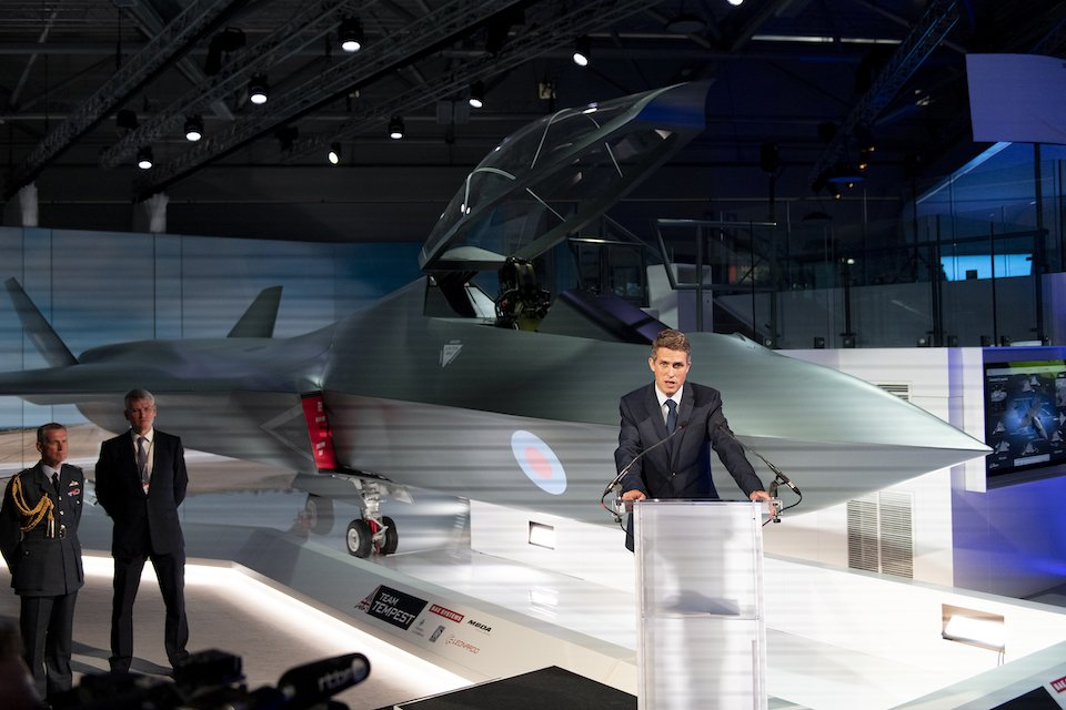 British Defence Secretary Gavin Williamson speaks at the Farnborough airshow in front of a full-scale mockup of Tempest, the Royal Air Force's future combat aircraft concept, for which he said £2 billion has been earmarked (UK MoD photo)