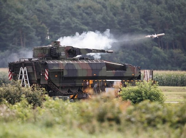 A Rheinmetall Lance turret, seen here fitted to a Puma IFV but which will also be fitted to Australia's Boxer Combat Reconnaissance Vehicle, fires a Spike LR anti-tank missile during German army trials (Rafael photo)