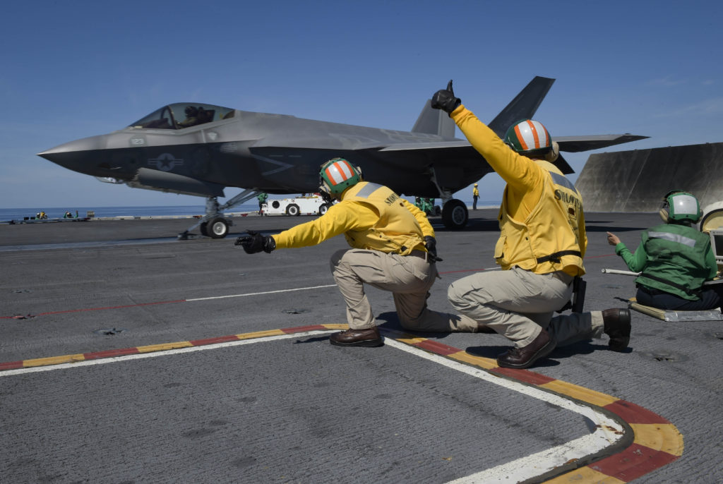 An F-35C Lightning II assigned to the Rough Raiders of Strike Fighter Squadron 125 lands on the flight deck of the Nimitz-class aircraft carrier USS Abraham Lincoln (CVN-72). Abraham Lincoln is currently underway conducting carrier qualifications (U.S. Navy photo by Mass Communication Specialist Seaman Maxwell Anderson/Released)