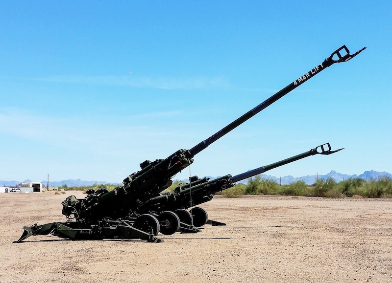 The U.S. Army's M777A2 and M777ER towed howitzers side by side at a test site. On September 19, 2018 the Army fired a modified M777 howitzer, doubling its previous range (U.S. Army photo)