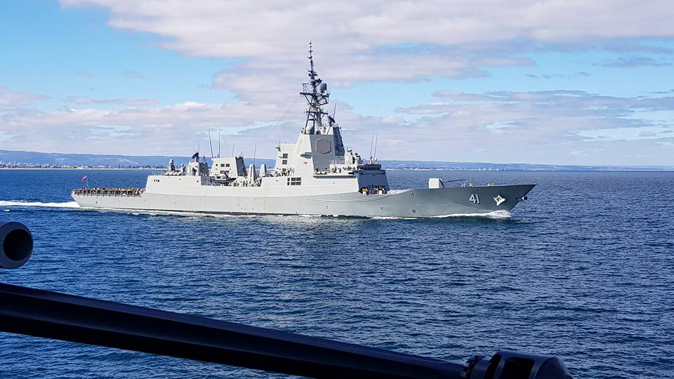 HMAS Brisbane (DDG-41) at sea during builders trials viewed from her sister ship, HMAS Hobart (DDG-39)