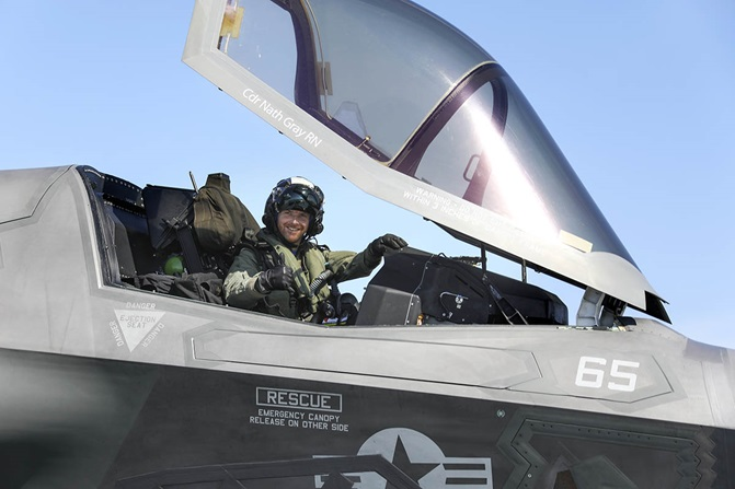 Royal Navy pilot Commander Nathan Gray in his F35B Lightning II jet gives a celebratory thumbs up after successfully landing on board HMS Queen Elizabeth (R08)