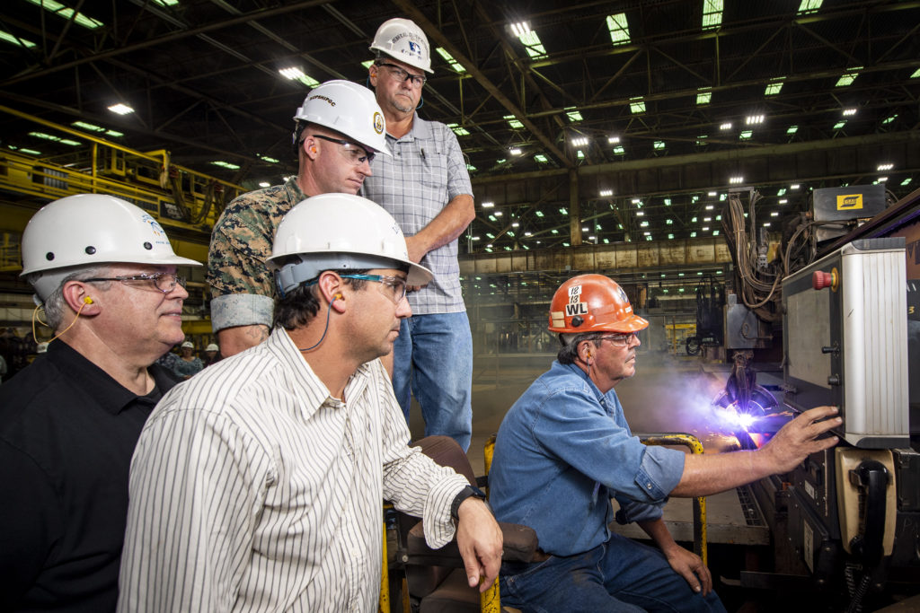 Paul Bosarge, a burner workleaderman at Ingalls Shipbuilding, starts fabrication of steel for the amphibious assault ship USS Bougainville (LHA-8). Also pictured (left to right) are Frank Jermyn, Ingalls' LHA 8 ship program manager; Lance Carnahan, Ingalls' steel fabrication director; U.S. Marine Corps Captain J.D. Owens, representing Supervisor of Shipbuilding, Gulf Coast; and Ricky Hathorn, Ingalls' hull general superintendent (Photo by Derek Fountain/HII)