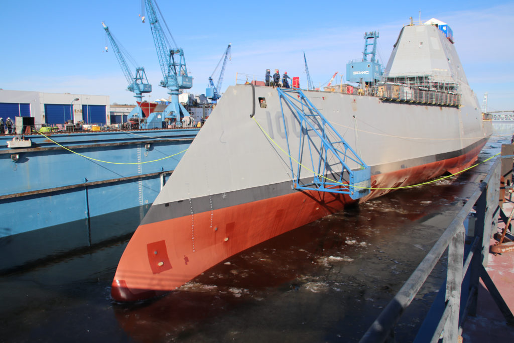 BATH, Maine (December 9, 2018) Following a multi-day process that includes moving the ship from the land level facility to the dry dock, the future USS Lyndon B. Johnson (DDG-1002) is made ready before flooding of the dry dock at General Dynamic-Bath Iron Works shipyard, and subsequent launching of the third Zumwalt-class destroyer (U.S. Navy photo courtesy of General Dynamics-Bath Iron Works/Released)