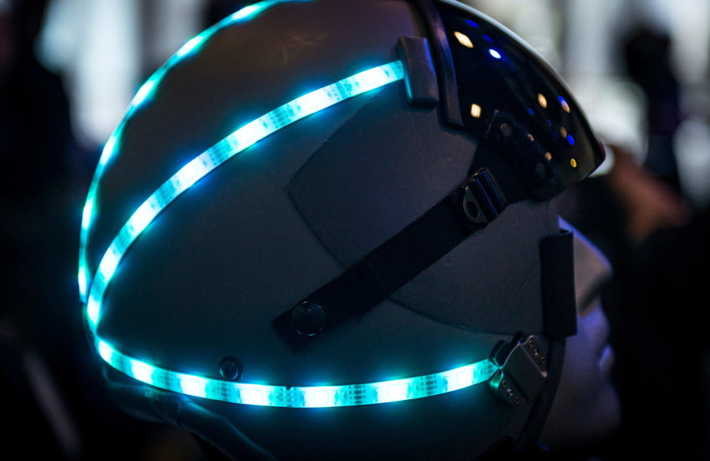 A helmet sits turned on at a booth during AFWERX Helmet Challenge at the Enclave Las Vegas, Nevada, November 14, 2018. The purpose of AFWERX Las Vegas is to solve problems for the Air Force by getting entrepreneurs and innovators to come together to brain storm ideas (U.S. Air Force photo by Airman 1st Class Bryan T. Guthrie)