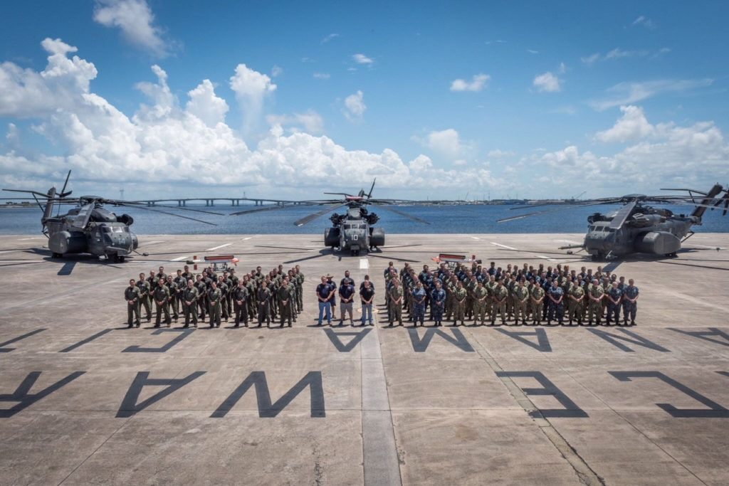3 MH-53E Super Stallion helicopters and personnel after the successful AQS-24C trials held in Panama City, Florida (Photo courtesy of U.S. Navy)