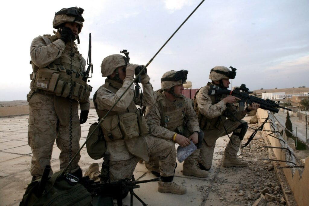 An ANGLICO team operates from a rooftop during the Iraq War (Photo credit: USMC Corporal Rocco DeFilippis Courtesy: United States Marine Corps)