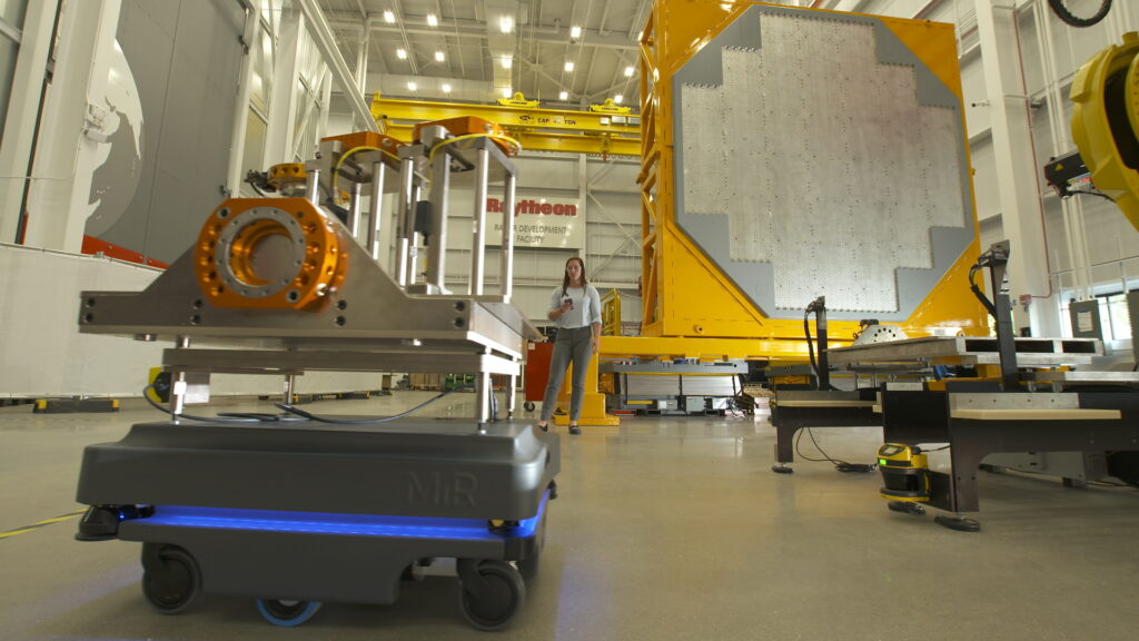 Robots and engineers work together in Raytheon's new radar development facility to assemble an array for the U.S. Navy's AN/SPY-6(V) radar