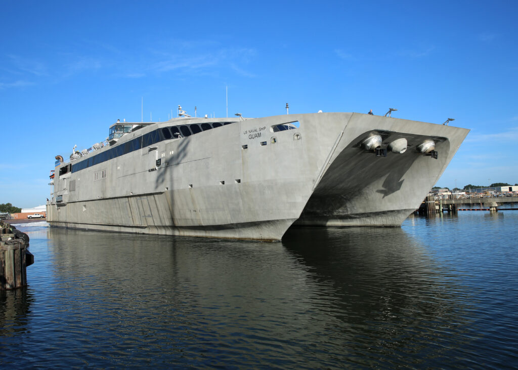 VIRGINIA BEACH, Virginia (October 5, 2017) – The Military Sealift Command high-speed transport USNS Guam (HST 1) gets underway from Joint Expeditionary Base Little Creek-Fort Story. Guam is underway to conduct testing and evaluation (U.S. Navy photo by Bill Mesta)