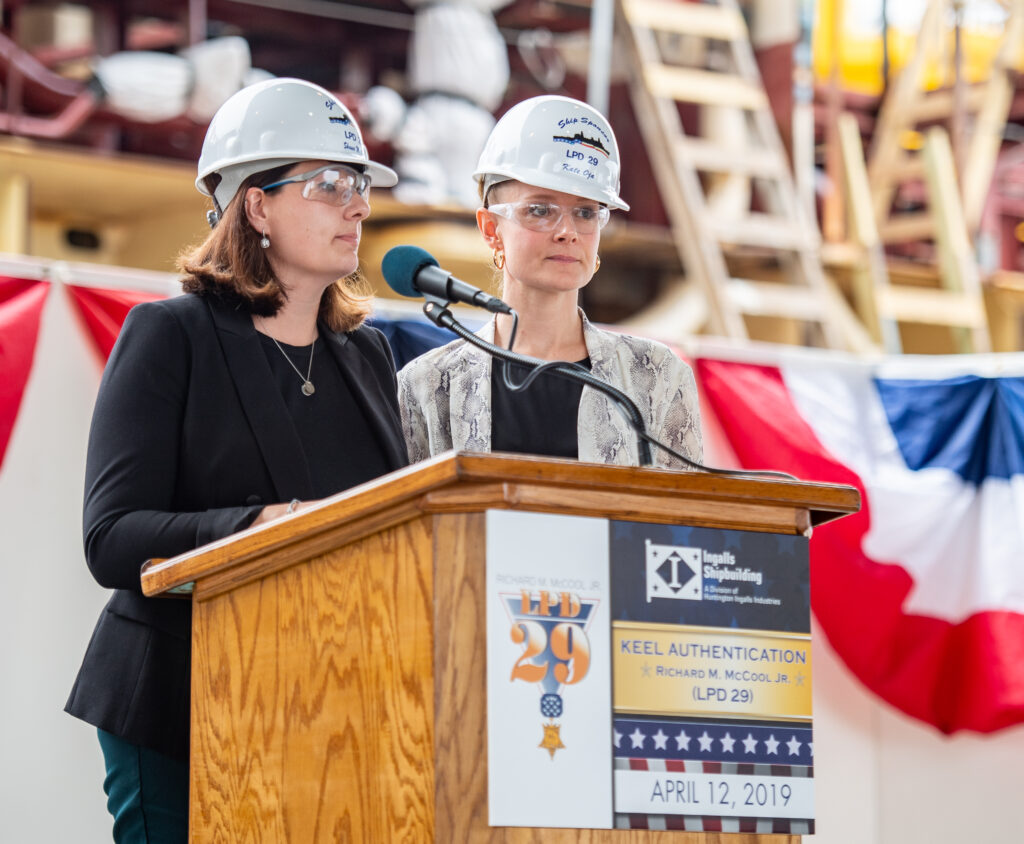 Shana McCool, left and Kate Oja, granddaughters of Richard M. McCool Jr., are ship's co-sponsors (Photo by Derek Fountain/HII)