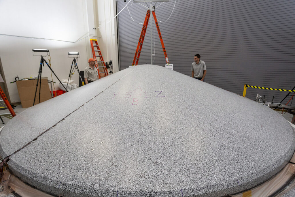 The Lockheed Martin-built heat shield, shown here in the testing phase, is just one component in the final aeroshell that will protect the Mars 2020 rover on its long journey to Mars